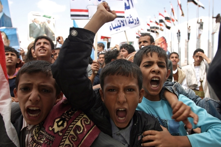 <p>Yemeni boys shout slogans as they attend a pro-regime rally in Sanaa on September 30, 2011, after a U.S. drone strike in Yemen killed Al Qaeda agent Anwar al-Awlaki, who had dual American and Yemini citizenship.</p>
