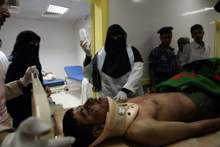<p>A Yemeni soldier is treated at a hospital in Sanaa after he was injured when a soldier packing powerful explosives under his uniform blew himself up in the middle of an army battalion in Sanaa on May 21, 2012, killing 96 troops and wounding around 300, a military official and medics said. The suicide attack was the deadliest in the country's capital since newly-elected President Abdrabuh Mansur Hadi pledged to oust Al Qaeda militants from Yemen's mostly lawless and restive southern and eastern provinces.</p>