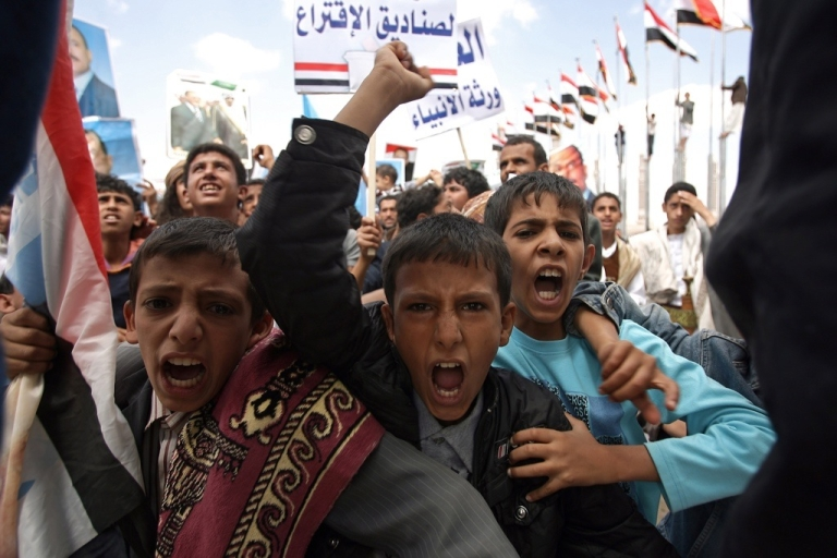 <p>Yemeni boys vent their anger at a rally in Sanaa on Sept. 30, 2011.</p>
