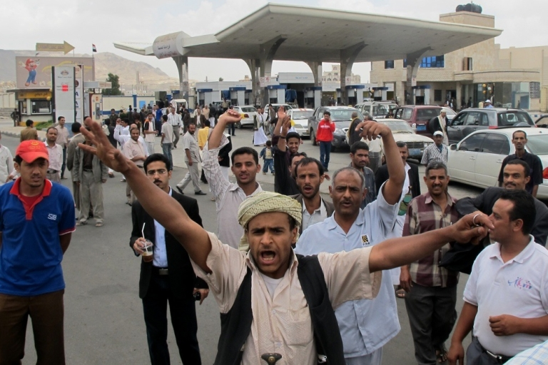 <p>Yemenis shout slogans at a petrol station amid a fuel shortage in the Yemeni capital of Sanaa on May 5, 2011.</p>