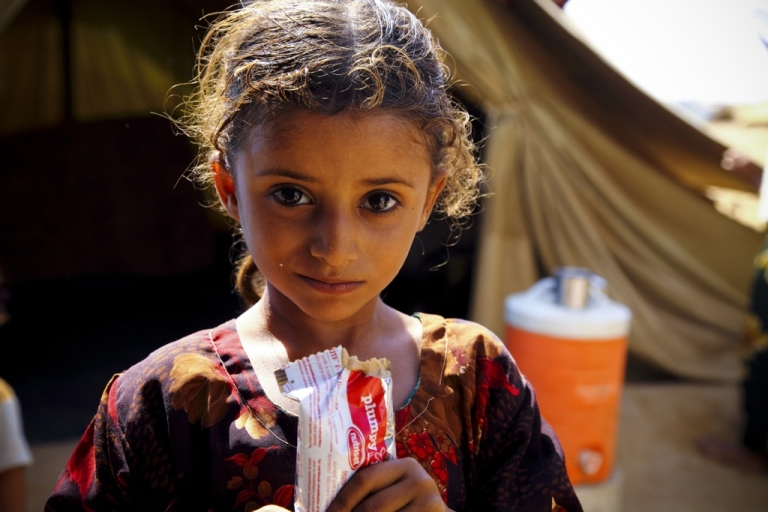 <p>While staying in a camp for war displaced, Shamha as-Saadi, 5, was diagnosed malnourished and given a pink wristband to wear to show she has not been getting enough to eat.</p>
