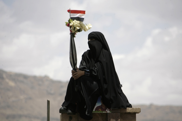 <p>A Yemeni anti-government protester attends a parade marking the anniversary of Yemen's reunification on the sidelines of a daily demonstration calling for the ouster of President Ali Abdullah Saleh in Sanaa on May 22, 2011.</p>