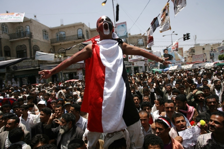 <p>Anti-government protesters shout slogans during a demonstration demanding the resignation of Yemeni President Ali Abdullah Saleh in Sanaa on May 14, 2011.</p>