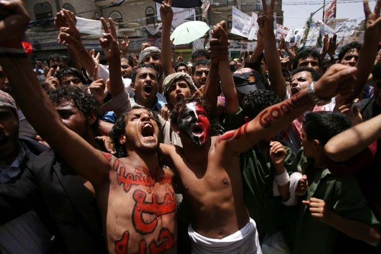 <p>Yemeni protesters, with anti-government slogans painted on their bodies, demonstrate against President Ali Abdullah Saleh's regime in Sanaa on May 9, 2011.</p>