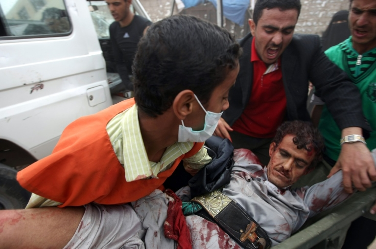 <p>A wounded Yemeni pro-reform protester is rushed into a makeshift hospital in Sanaa's landmark Change Square on November 24, 2011. Loyalists of President Ali Abdullah Saleh shot dead at least five people in the Yemeni capital casting a pall over a hard-won deal for his departure after 33 years in power.</p>