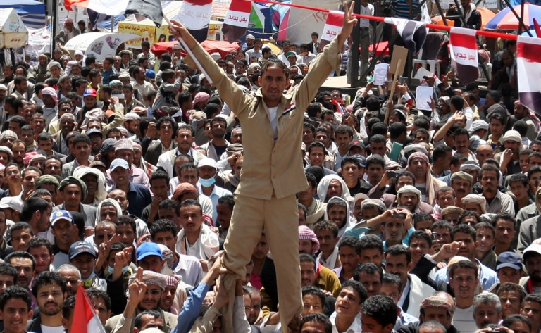 <p>Yemenis protest against the regime of President Ali Abdullah Saleh after 32 years in power, in Sanaa on March 14, 2011.</p>