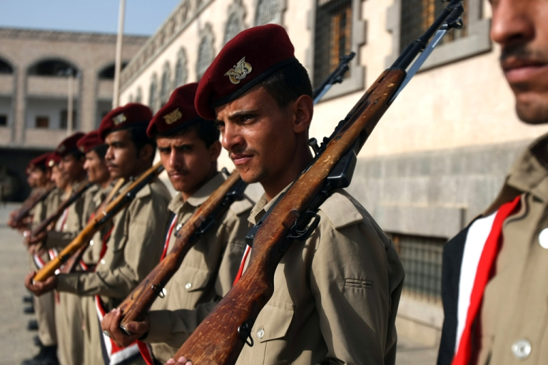 <p>Yemeni soldiers attend the funeral procession of nine police cadets who were killed when an Al-Qaeda suicide bomber blew himself up at the entrance of a police academy, in Sanaa on July 14, 2012.</p>