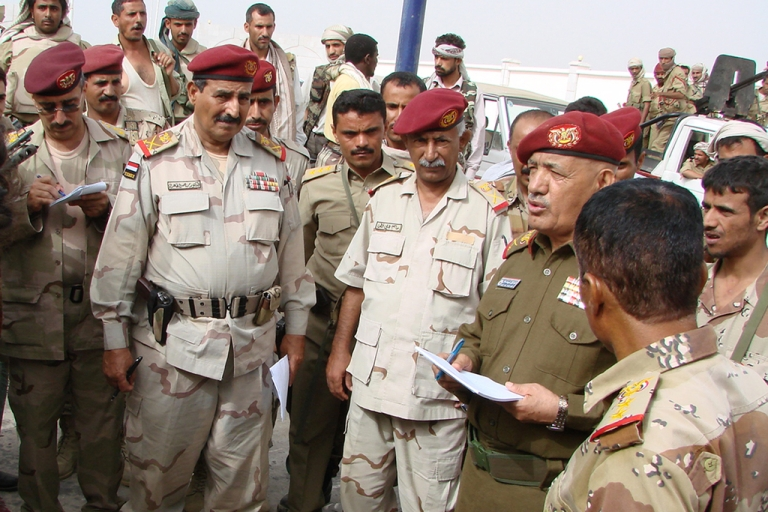 <p>Yemeni General Ali Salah, deputy chief of staff for military operations, speaks to defense officials as he visits Yemen's restive Abyan province on March 6, 2012. The number of soldiers killed in an assault by Al Qaeda militants on an army camp in Yemen's restive Abyan province on April 9, 2012 is somewhere between five and 13, according to various official sources.</p>