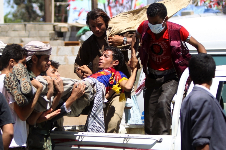 <p>Yemenis rush a wounded protestor to a makeshift hospital during an anti-regime rally in Sanaa on October 15, 2011. Yemeni police opened fire on demonstrators in the capital demanding the resignation of President Ali Abdullah Saleh.</p>