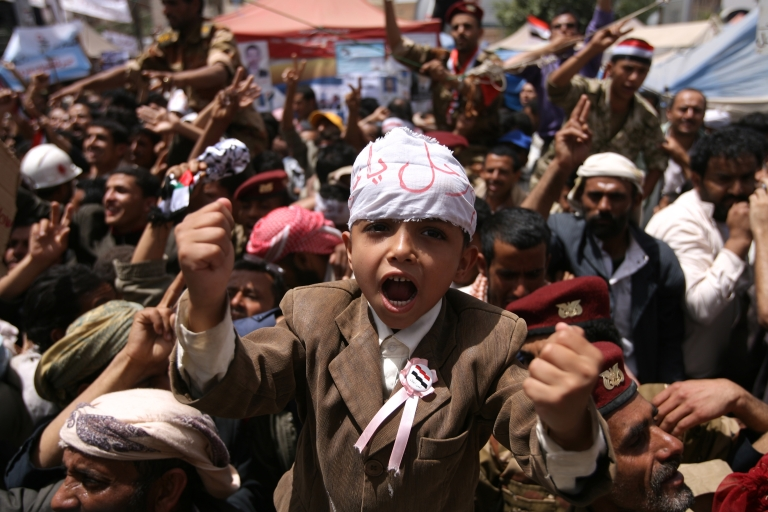<p>Yemeni anti-government protesters shout slogans during a demonstration demanding the resignation of Yemeni President Ali Abdullah Saleh in Sanaa on March 31, 2011 as Saleh and his opponents prepared for another tense Friday in a two-month-long showdown with calls for rival demonstrations.</p>