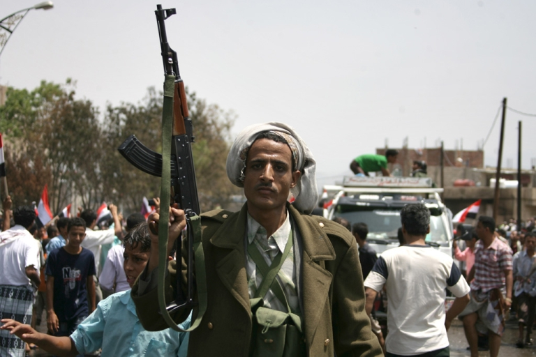 <p>An armed tribesman in Yemen's second-largest city Taiz. Since August, some 1,000 tribesman loyal to the Sanaa government have been fighting against militants from Al Qaeda in the Arabian Peninsular, which US officials deem to be the most serious Al Qaeda threat to US security. (MOHAMMED HUWAIS/AFP/Getty Images)</p>