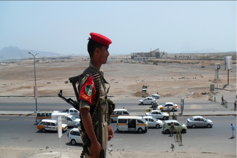 <p>Yemeni security forces secure a main road in the southern port of Aden following the seizure of Saudi Arabia's deputy consul by unknown gunmen outside his home in the southern city on March 28, 2012.</p>