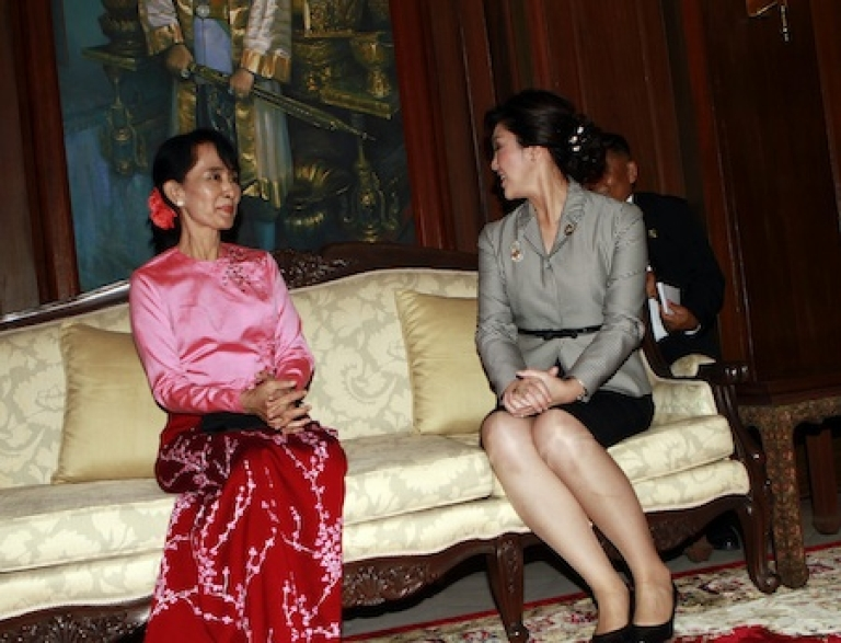 <p>Myanmar democracy icon Aung San Suu Kyi (L) talks with Thai Prime Minister Yingluck Shinawatra at the embassy of Thailand in Yangon on December 21, 2011. Detained for most of the past two decades, Suu Kyi was released from her latest stint under house arrest a few days after a controversial election in November last year, which her opposition party boycotted.</p>