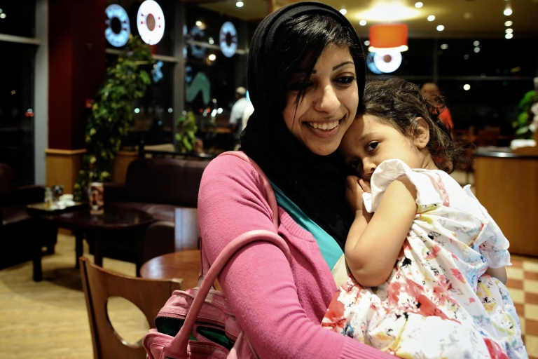 <p>Bahraini opposition activist Zainab al-Khawaja, daughter of prominent jailed opponent Abdulhadi al-Khawaja, holds her daughter Jude as they sit in a coffee shop in the village of Abu Saiba.</p>