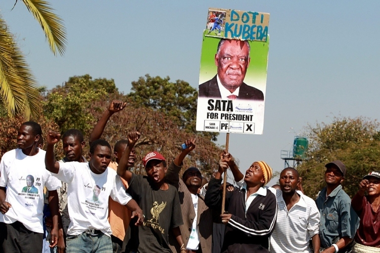 <p>Supporters of Zambia's opposition Patriotic Front leader Michael Sata demonstrate on August 9, 2011 outside the high court of Lusaka where Sata filed his nomination ahead presidential elections.</p>