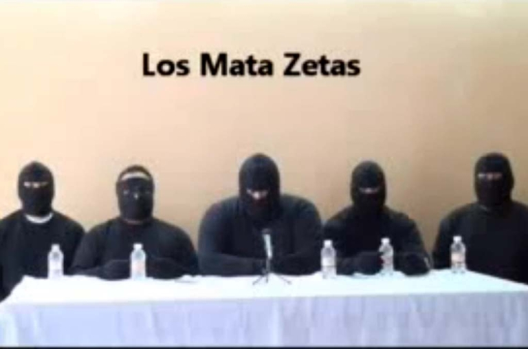 <p>Screen capture of a paramilitary group which vowed to 'eliminate' the Zetas, reputedly Mexico's most violent drug gang, in a video posted on the Internet on September 24, 2011 several days after 49 bodies were found on the streets of Veracruz.</p>