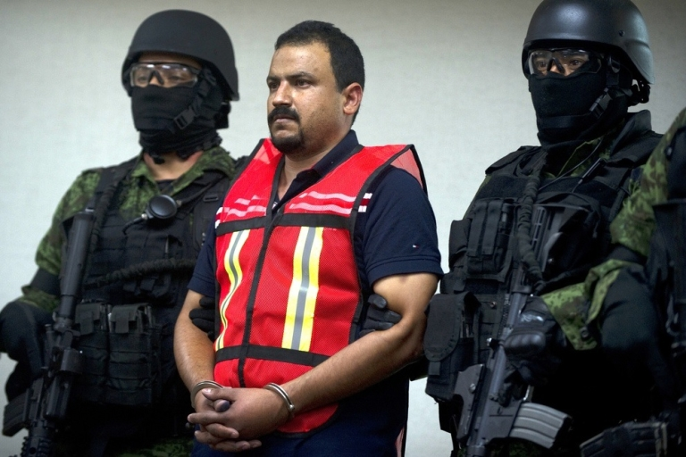 <p>Mexican Army soldiers with Juan Carlos Garza Rodriguez, aka 'El Juanillo', alleged member of the drug cartel 'Los Zetas.' Zetas members keep getting picked up, but is that just because they're so thick on the ground?</p>