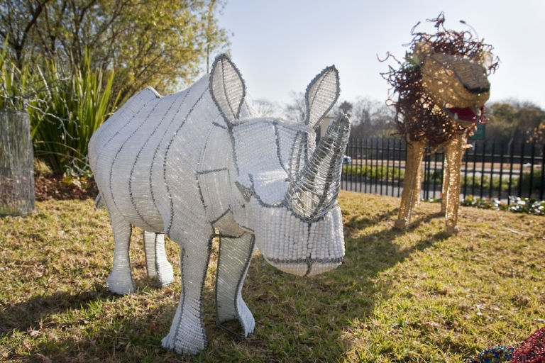 <p>Drunk would-be rhino poachers, beware. This one is also an impostor - specifically, it's a beaded wire sculpture of a rhinoceros, created by Zimbabwean artists working on a street corner in Johannesburg, South Africa.</p>
