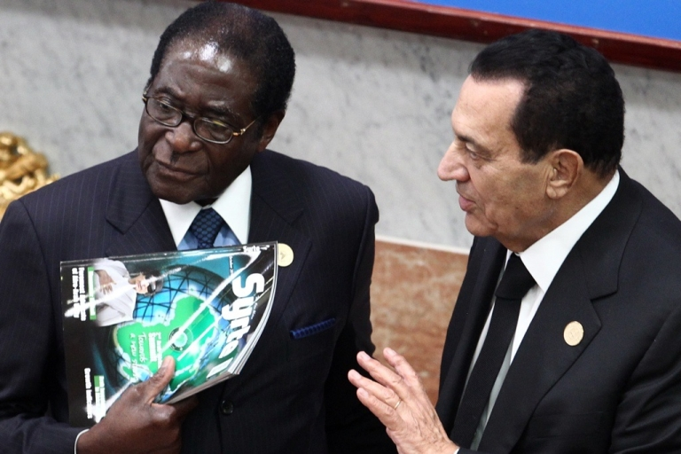 <p>Best buddies — but now one of them has been toppled from power. Zimbabwe President Robert Mugabe, left, listens to Egyptian President Hosni Mubarak at the 2nd Afro-Arab Joint Summit at the Libyan coastal city of Sirte, on October 10, 2010.</p>