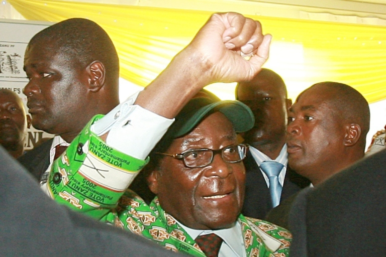 <p>Zimbabwe's President Robert Mugabe gives his trademark clenched fist salute. Mugabe said if America, Britain and the European Union maintain personal sanctions against him and his supporters, his regime will seize Western-owned firms operating in Zimbabwe.</p>