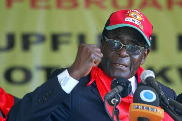 <p>Zimbabwe's President Robert Mugabe speaks during a rally marking his 88th birthday in Mutare on February 25, 2012 with a trademark attack on gays and foreigners at a rally of his supporters.</p>