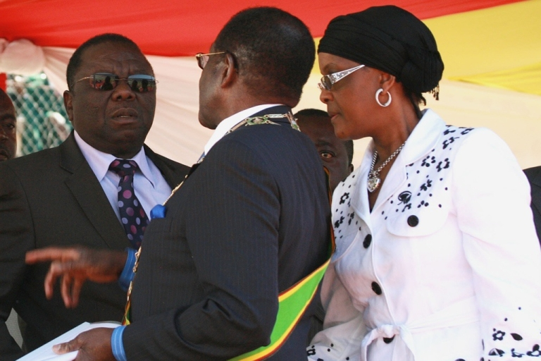 <p>Zimbabwean President Robert Mugabe, center, and his wife Grace, right, chat with Prime Minister Morgan Tsvangirai, left, at the National Sports Stadium in Harare.</p>