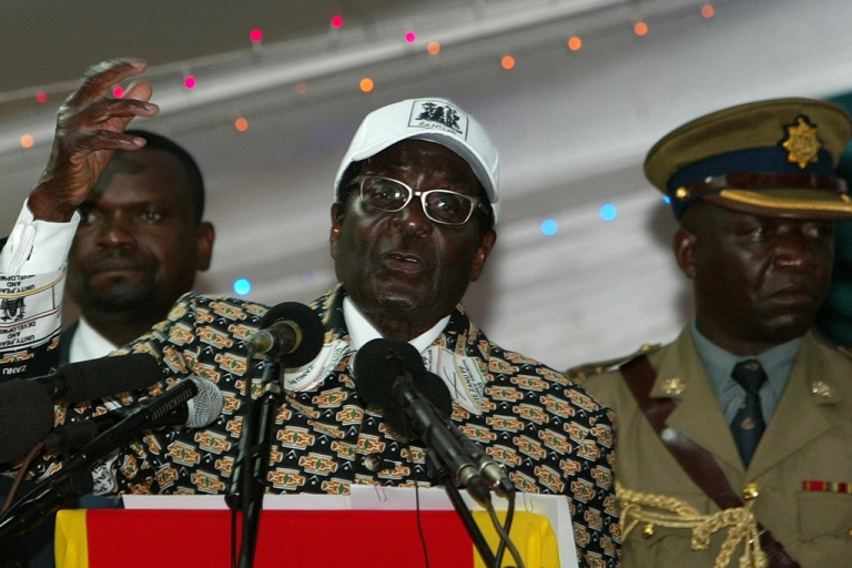 <p>Zimbabwe's President and leader of ZANU-PF Robert Mugabe calls for elections in 2012 at the party's annual conference in Bulawayo, on December 10, 2011. Mugabe said he has no intention of retiring, saying doing so would be an act of 'cowardice.'</p>
