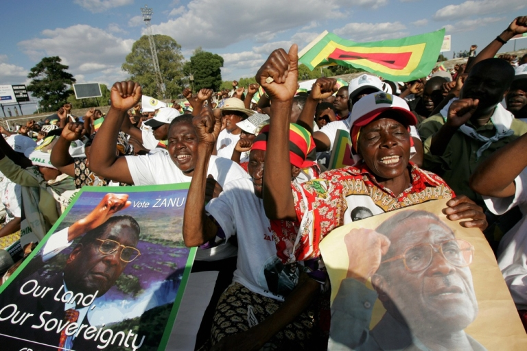 <p>Supporters of Zimbabwe President Robert Mugabe and leader of the Zimbabwe African National Union - Patriotic Front party dance at Mugabe's campaign rally in Harare on March 28, 2008.</p>