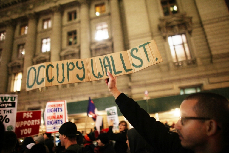 <p>Members of the Transportation Union Local 100 and Occupy Wall Street supporters protested in New York City before marching to Zuccotti Park on Dec. 15, 2011.</p>