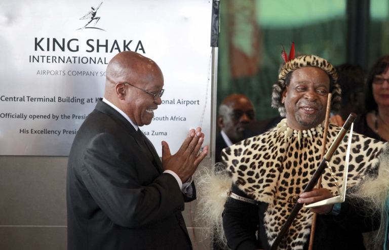 <p>South African President Jacob Zuma (L) applauds Zulu King Goodwill Zwelithini (R) after officially opening the Central Terminal building of Durban's new King Shaka International Airport and Dube Trade Port, north of Durban, South Africa.</p>